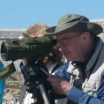a man birdwatching