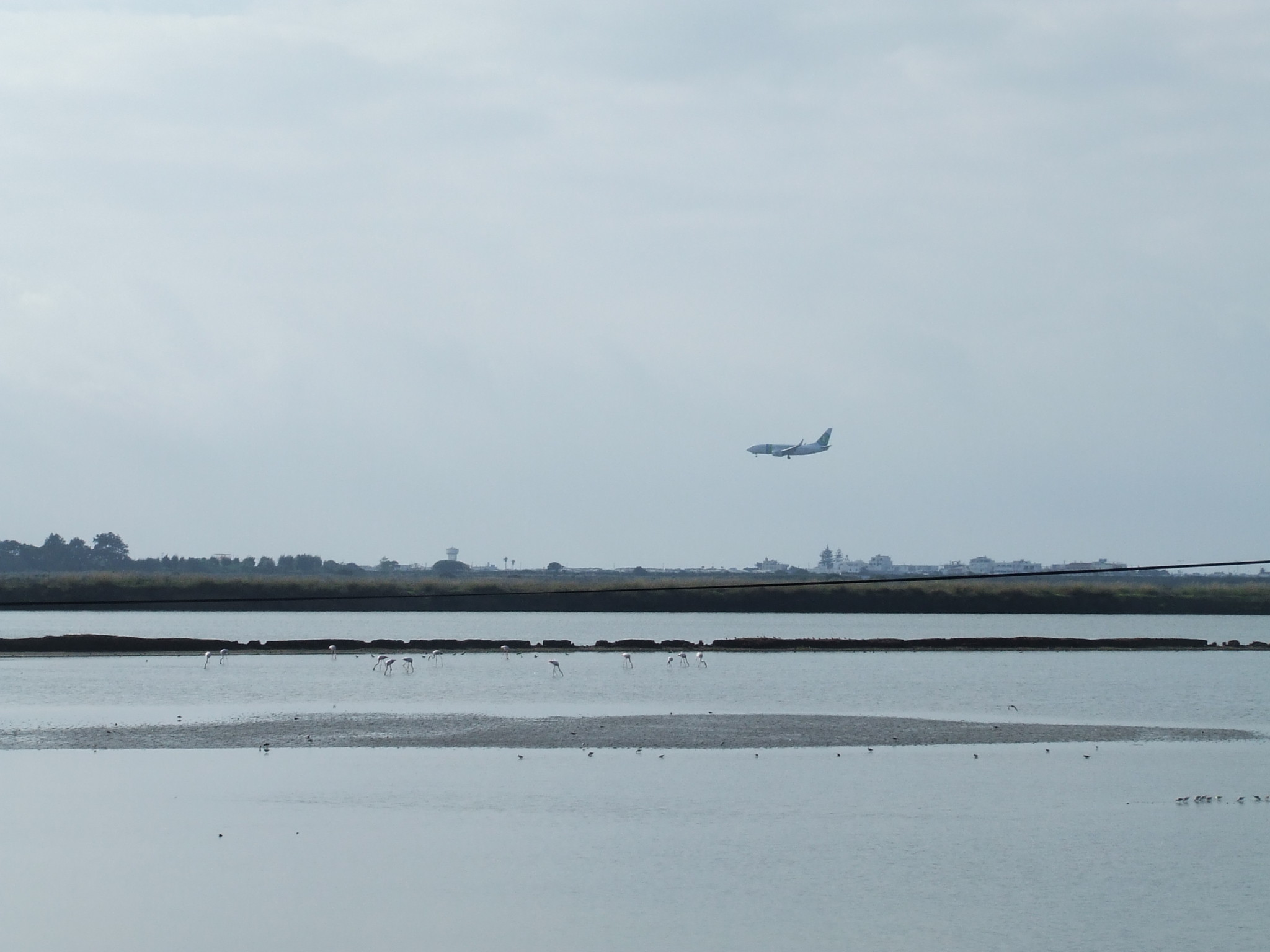 Plane flying over saltpans